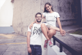 smiling-couple-wearing-t-shirts-mockup-in-an-urban-environment-a20588 (1).png