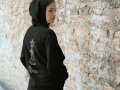 hoodie-mockup-of-a-woman-standing-in-front-of-a-brick-wall-a7881.png